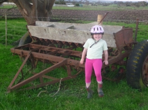 Zoe with a seed drill from the 50s