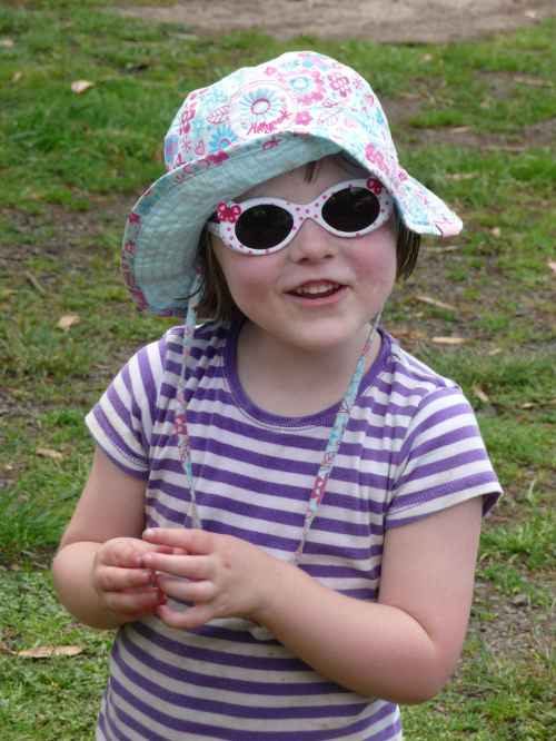 Zoe in new farm hat and sunnies